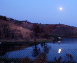 Near full moon coming up over Cater Reservoir.